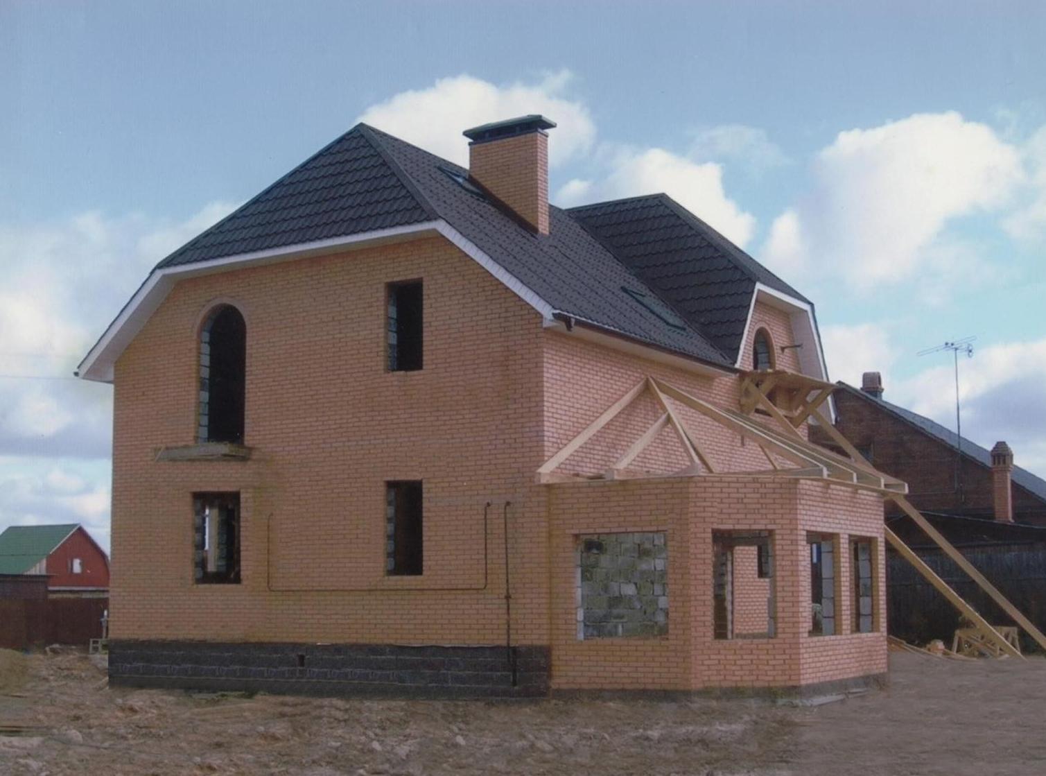 Шикарный кирпичный дом фото